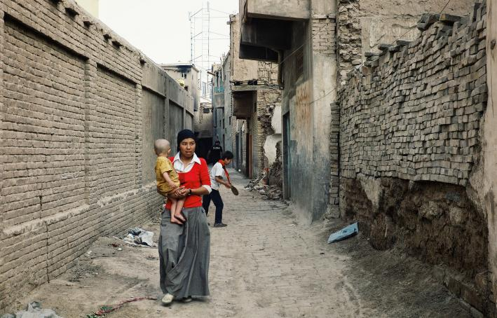 Young uighur mother with child in Kashgar, China