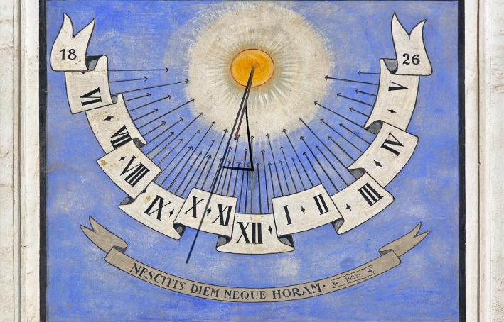 Medieval sun dial clock at church wall in Ljubljana, Slovenia