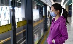 Asian woman waiting for subway