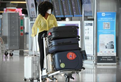 Air Travelers Wear Masks as a Precaution against Covid-19