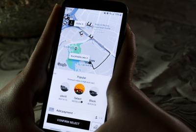 Using the Uber app on a smartphone